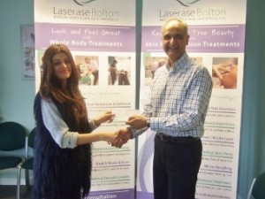 Deepa Khatri receives her vouchers from Dr Kiran Patel